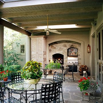 Outdoor kitchen with wrought iron chairs...use our breakfast table outside once we get a new one?