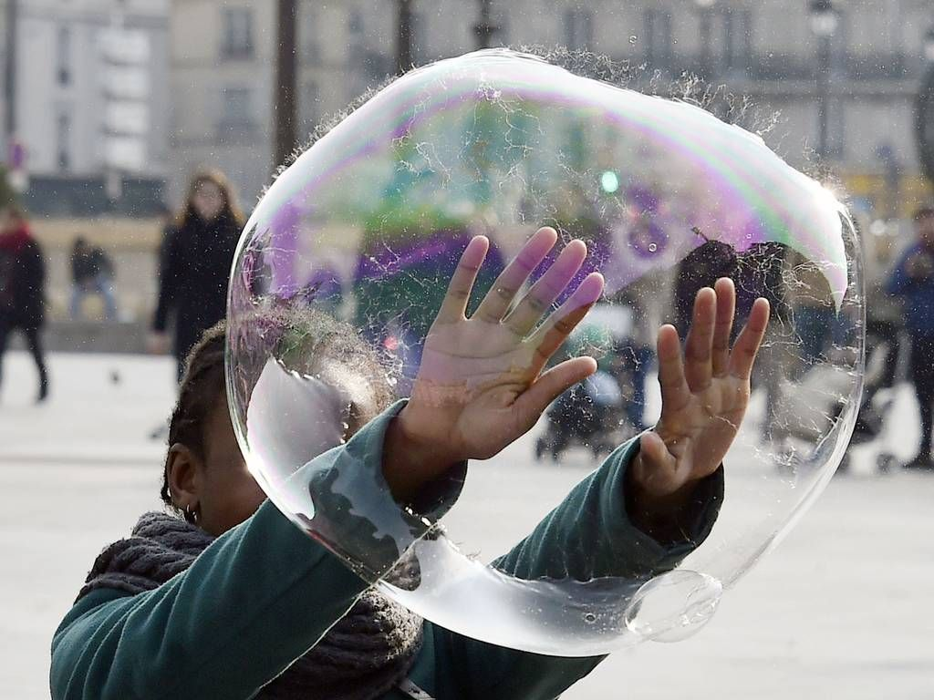 14 March 2015 A child plays with a soap bubble on the city hall plaza in Paris DOMINIQUE FAGET/AFP/Getty Images