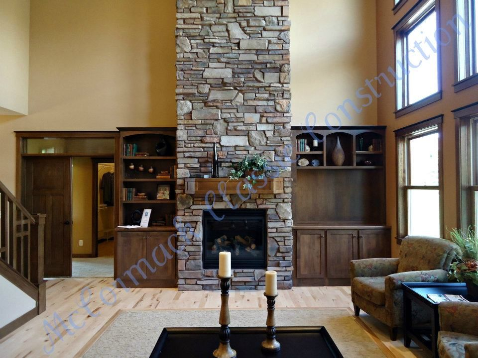 A very bold fireplace in a model homes great room with ...