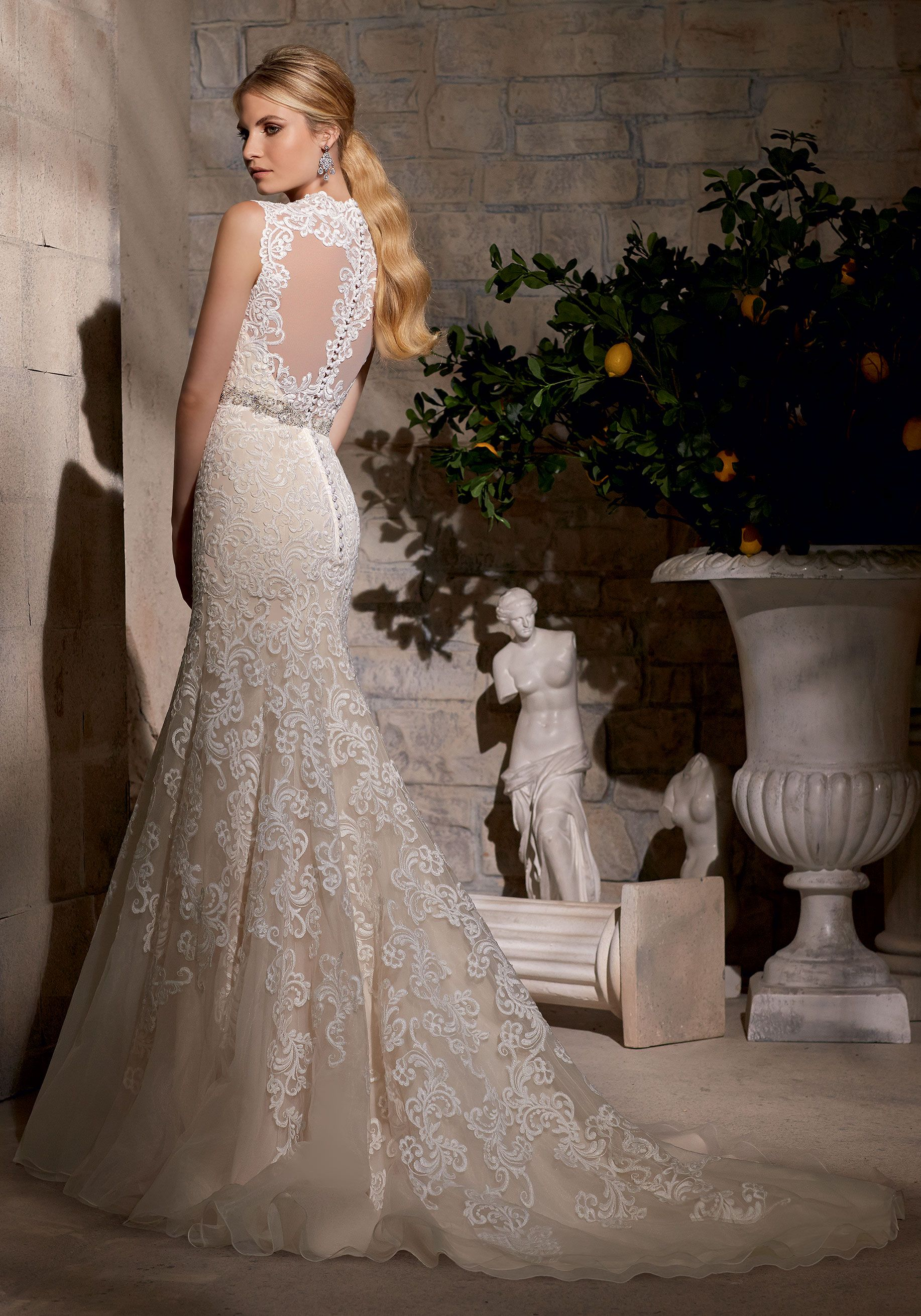 Mori lee madeline gardner wedding dress  Ornate embroidery adorns this Bridal Dress Diamante beading creates
