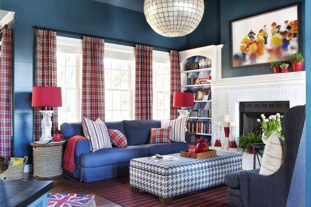 This playful family room lights up a home shared by two young parents and their two active sons. Interior designer Brian Patrick Flynn deliberately used youth as a part of this room's decor, with original framed photography of 1980s Duplo figures, as well as playful accessories and a bold, vibrant palette of navy blue and fire engine red.