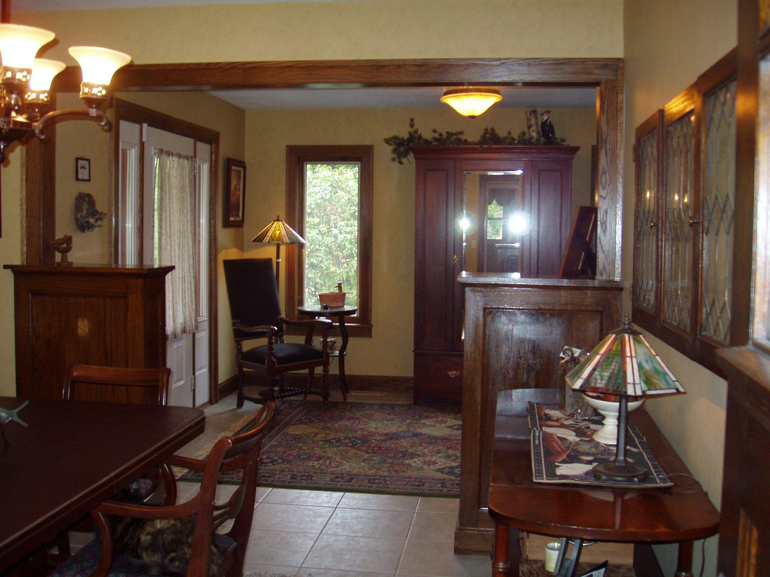 cabinets from the 1940's bungalow were re-installed into their new home in this new dining/foyer addition.