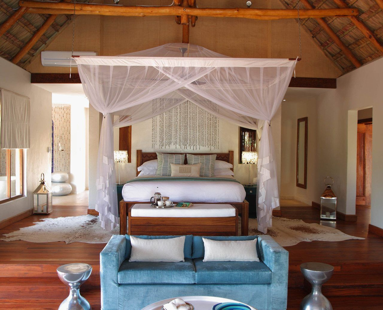 Bed Bedroom Canopy Canopy Bed Charming Cozy Homey Hotels Hut Luxury Rustic Indoor Luxury Living Room Blue Curtains Living Room Living Room Interior Design Cozy