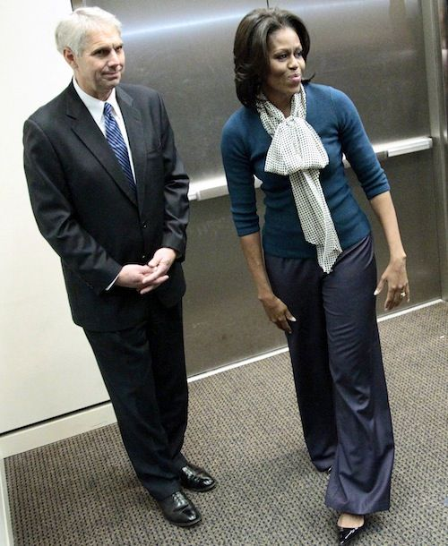 On the style front, Mrs. O addressed secret service members wearing a dot bow blouse, teal sweater and blue trousers. For gardening, Mrs. O changed into a J.Crew Jester sweater and slim black pants.