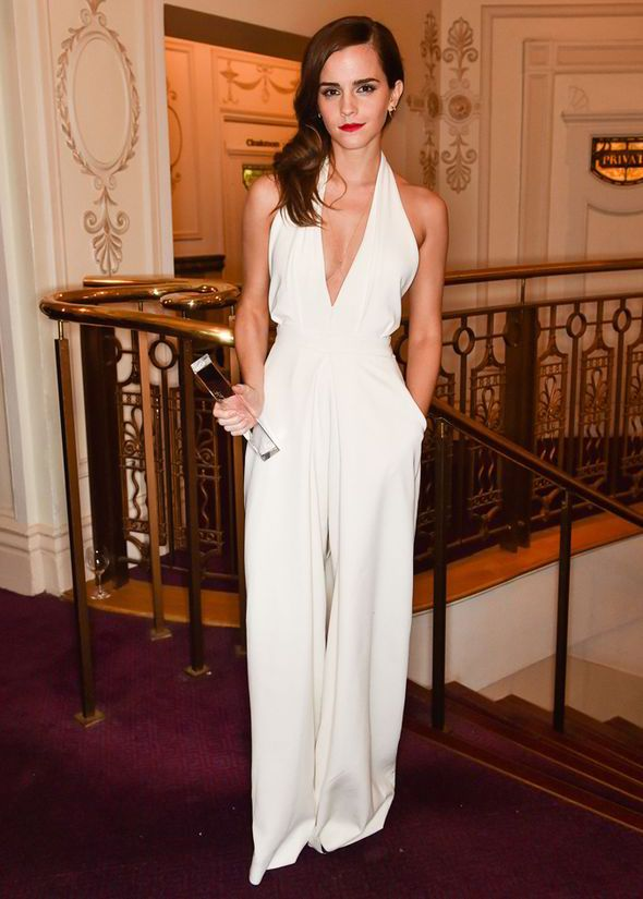 7295bc7116 Emma showed off a hint of cleavage thanks to her white halterneck jumpsuit