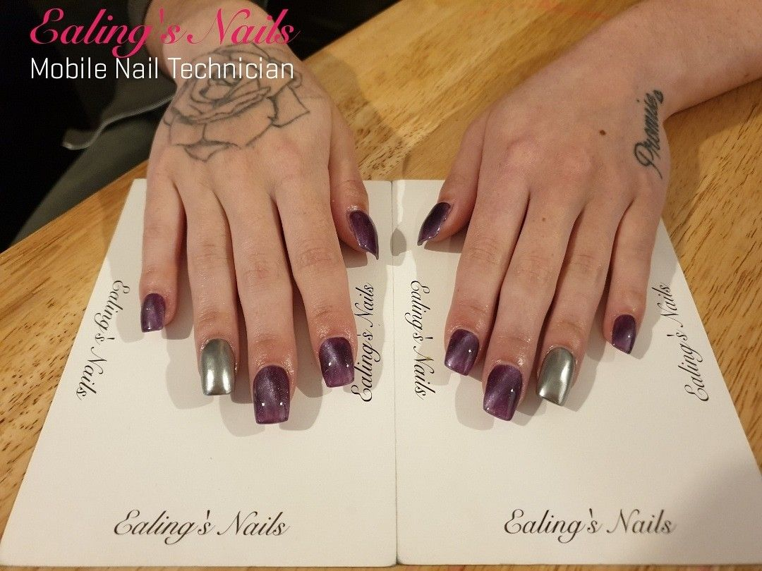 Acrylic extensions with Purple cateye gel polish & chrome