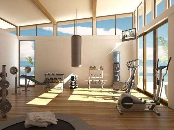 A Complete Workout Room At Home Including Treadmill Hand Weights TV Punching