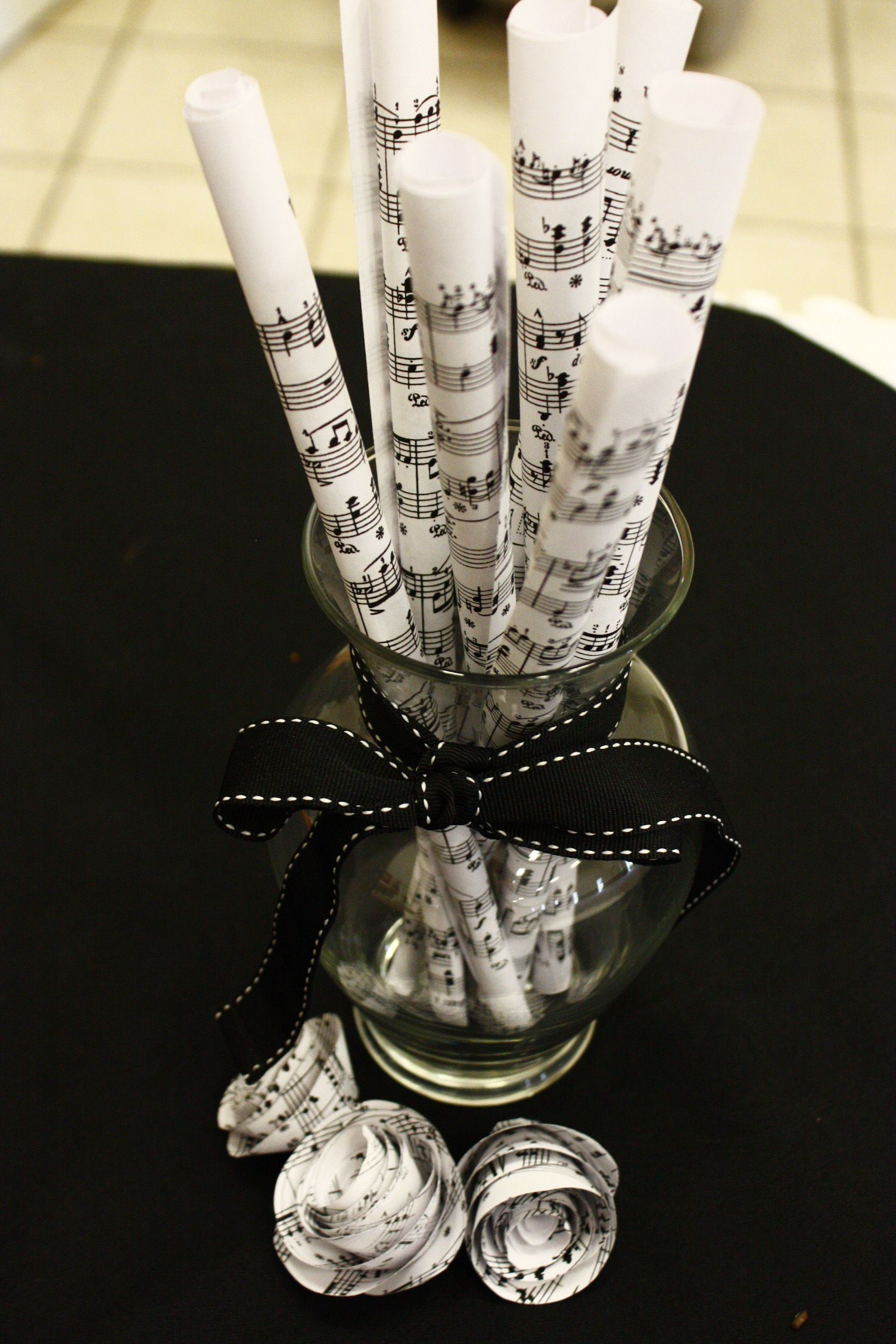 Recital Decorations Rolled Up Sheet Music In A Vase With