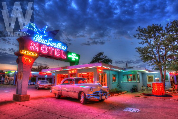 route 66 new mexico a 1951 pontiac eight is illuminated by the neon lights of the art deco. Black Bedroom Furniture Sets. Home Design Ideas
