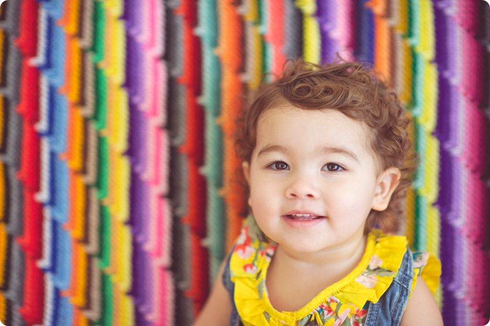child studio photography, rainbow blanket
