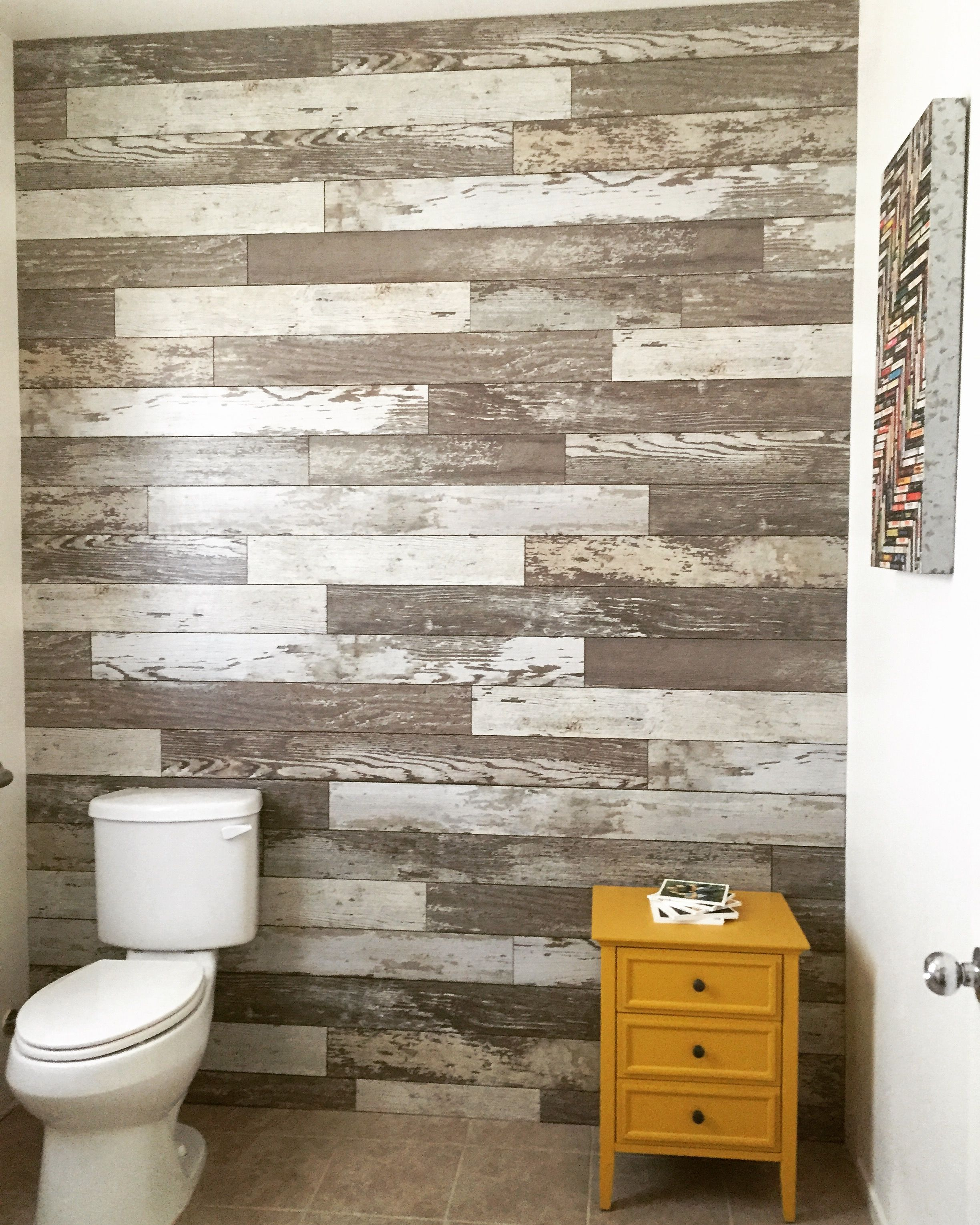 My Husband Created A Laminate Wall Using Bull Barn Oak It S So Awesome Flooring On Walls Laminate Flooring On Walls Laminate Flooring Diy