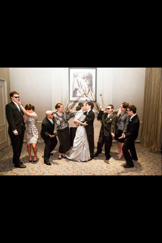 Silver wedding dress.  Cute bridal party photo