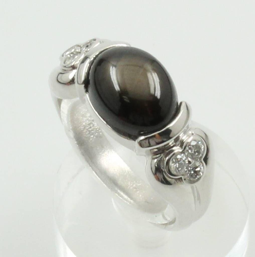 Ring mit Saphir und Brillanten, WG 750/000, ovaler, feiner Sternsaphir ca. 4.46 ct, 6 Brill. zus. ca. 0.22 ct Weiß/si, RW ca. 52, Schätzpreis EUR 2300.-  ehemaliger Verkaufspreis 1200,- €  jetzt 960,- €