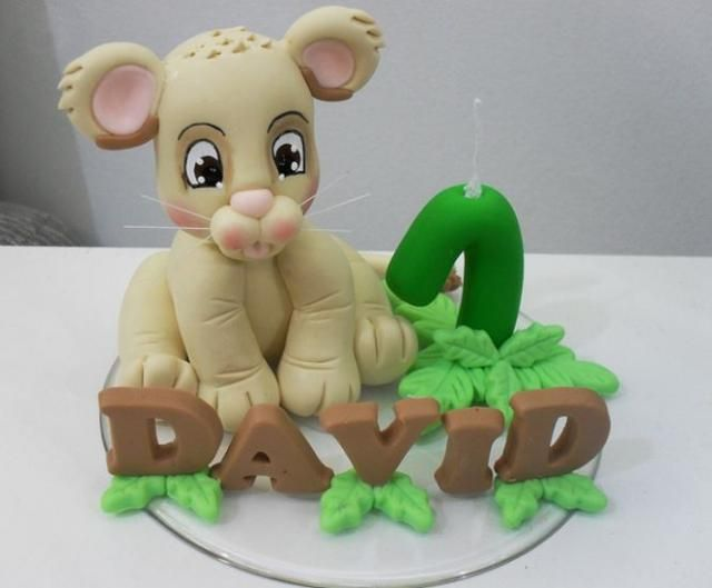 birthday cakes for boys Sculpted baby lion first birthday cake