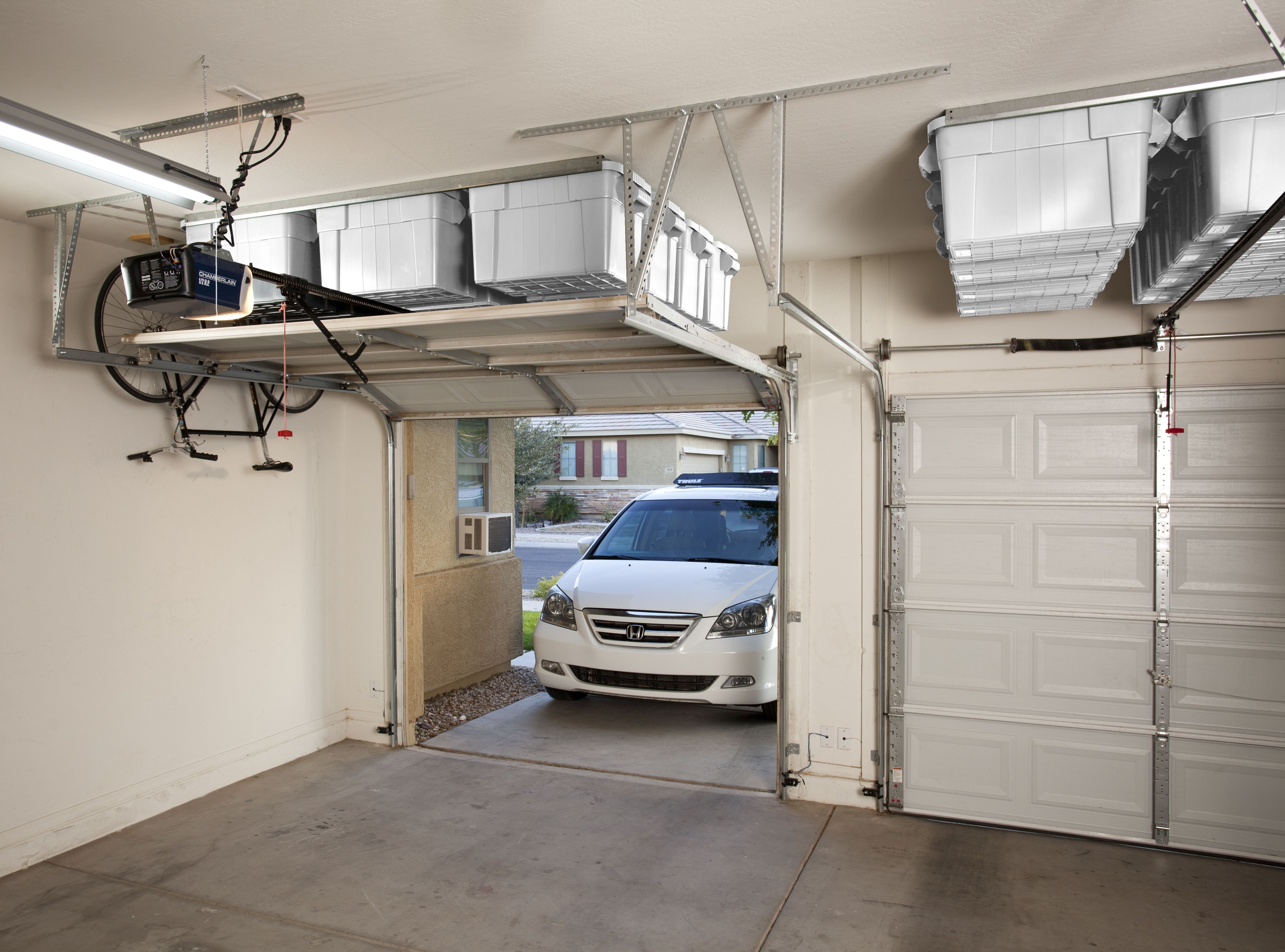 Not Visible From The Street And Attractive From Within The Garage Taking Garage Storage To An A Garage Storage Solutions Overhead Garage Storage Door Storage