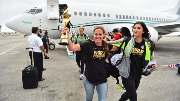 Back home in America with the World Cup Trophy. #USWNT