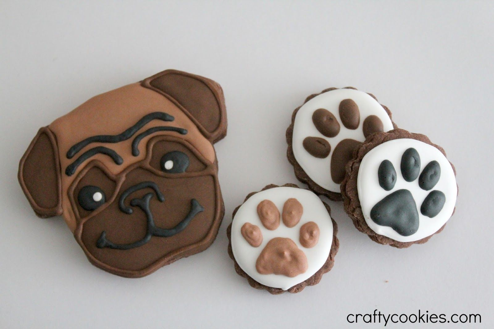 Pug decorated sugar cookies. Royal icing. Fawn, brown. Paw ...