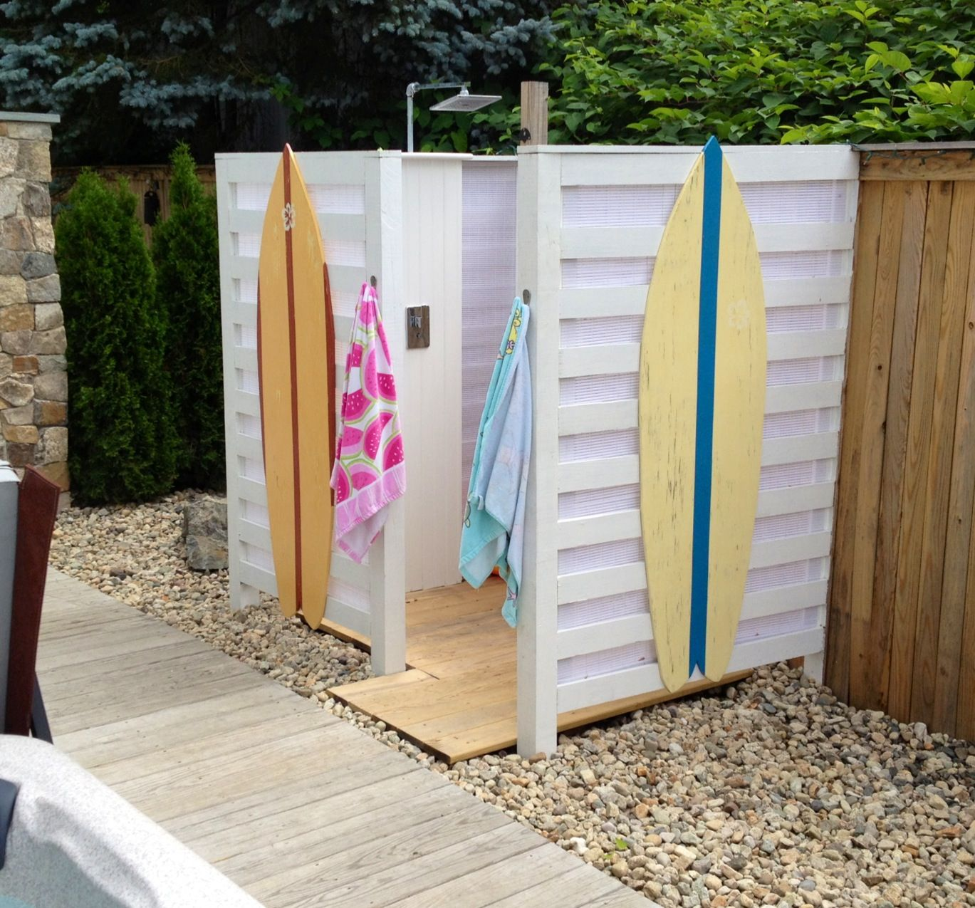 cute beachy outdoor shower with surfboard accents outdoor