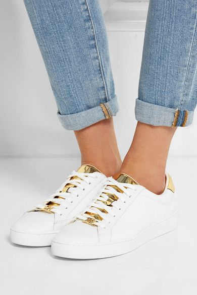 62b05445c1c4b Sole measures approximately 35mm  1.5 inches White and gold leather Lace-up  front