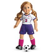 """Soccer Outfit        A purple-and-white soccer jersey     Purple sport shorts with a side-stripe     Knee-high socks and athletic shoes with """"cleats""""     Shin guards to protect her while she plays     A doll-sized soccer ball  Z"""