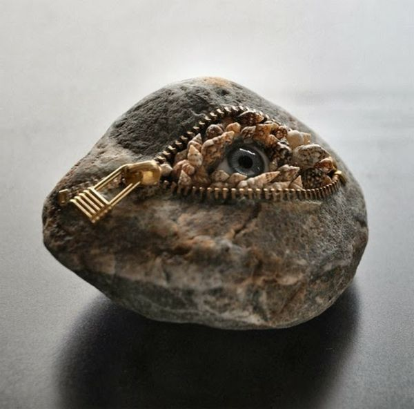 steinskulpturen auge reißverschluss