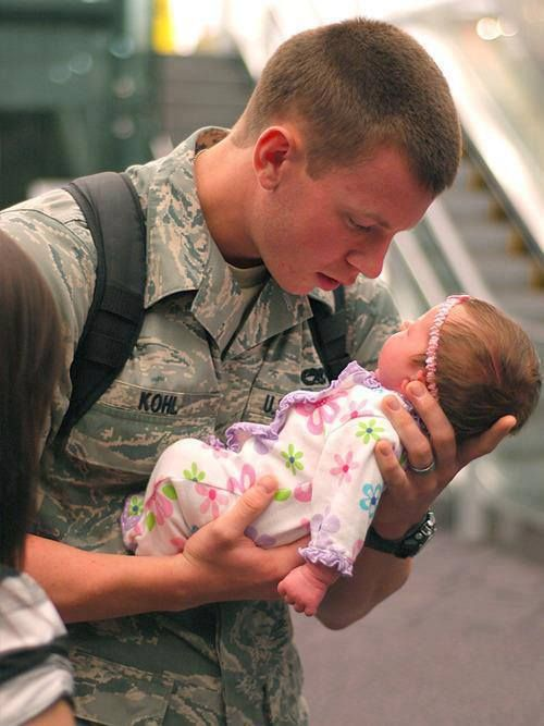 First time for this soldier to see his 3 week old daughter. He is looking at her like she is made of gold. Beautiful. <3