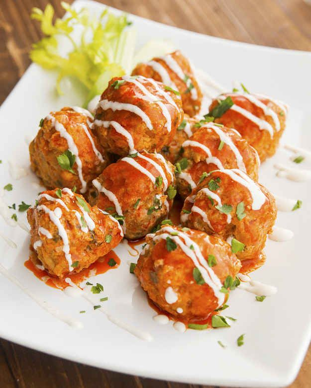 Slow Cooker Buffalo Chicken Meatballs - Jesus Christ these are INSANE! Skipped the egg, used celery leaves instead of fresh parsley, half the blue cheese, added some parm and siracha. cooked them in the oven at 350 for 60 minutes
