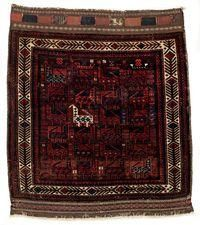 This bag face showing a dense bird design and tree forms reminiscent of fish bones in the border once belonged to a khorjin. Its comparatively fine weave and velvety pile wool makes it one of the high-quality examples of its kind. – Full pile preserved except for some moth damage; good condition, with the original sides, upper closure band and a brocaded decorative band at the bottom.  , Khorasan 89 x 77 cm Late 19th 1,500.00 €