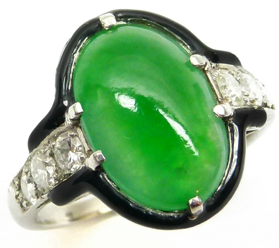 Jade, diamond, and enamel ring by Cartier. Art Deco or Art Deco-inspired. Via Diamonds in the Library.