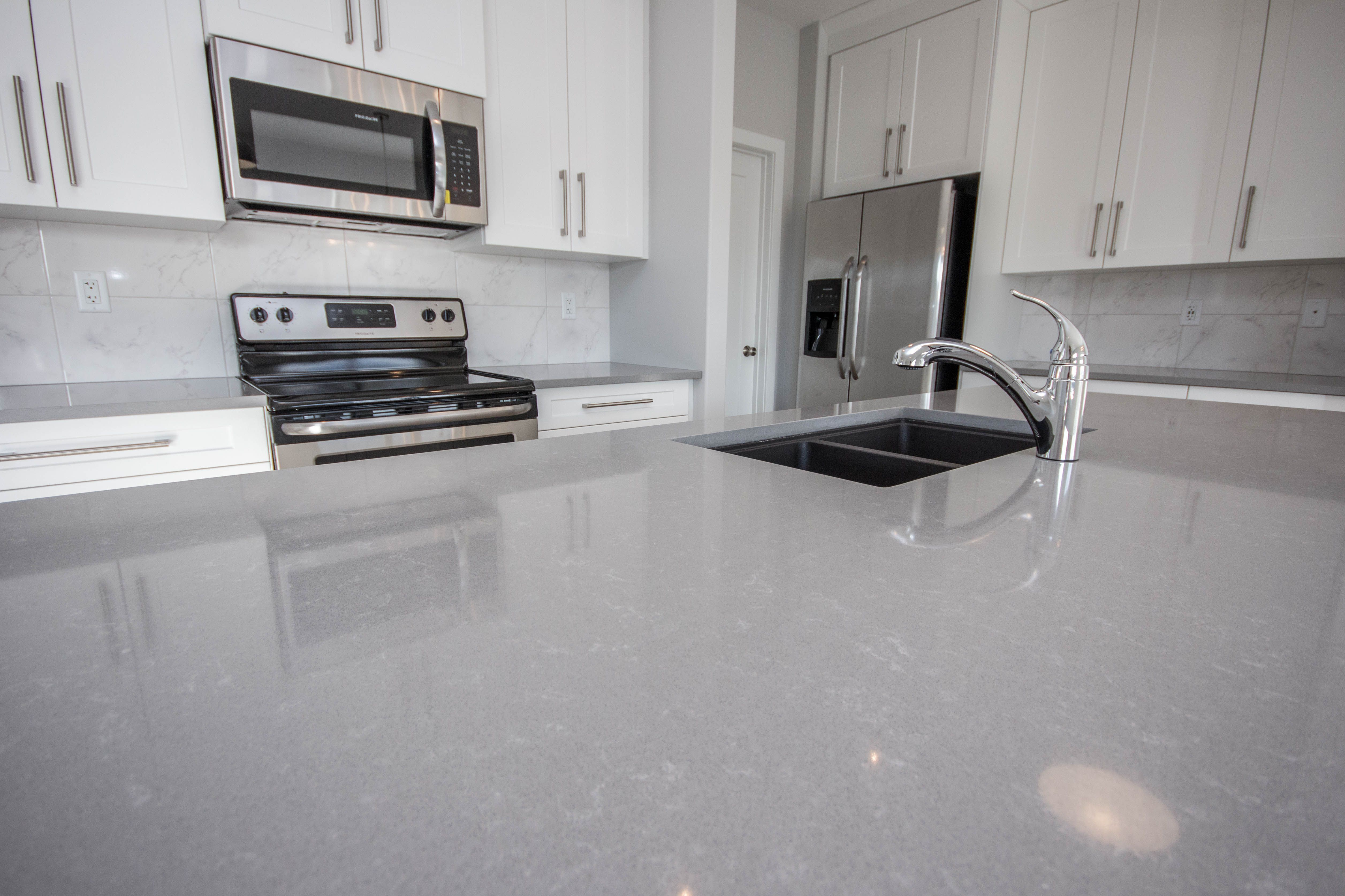 Uptown Grey Quartz You Can Never Go Wrong Gray Quartz Countertops Mosaic Tile Kitchen Kitchen
