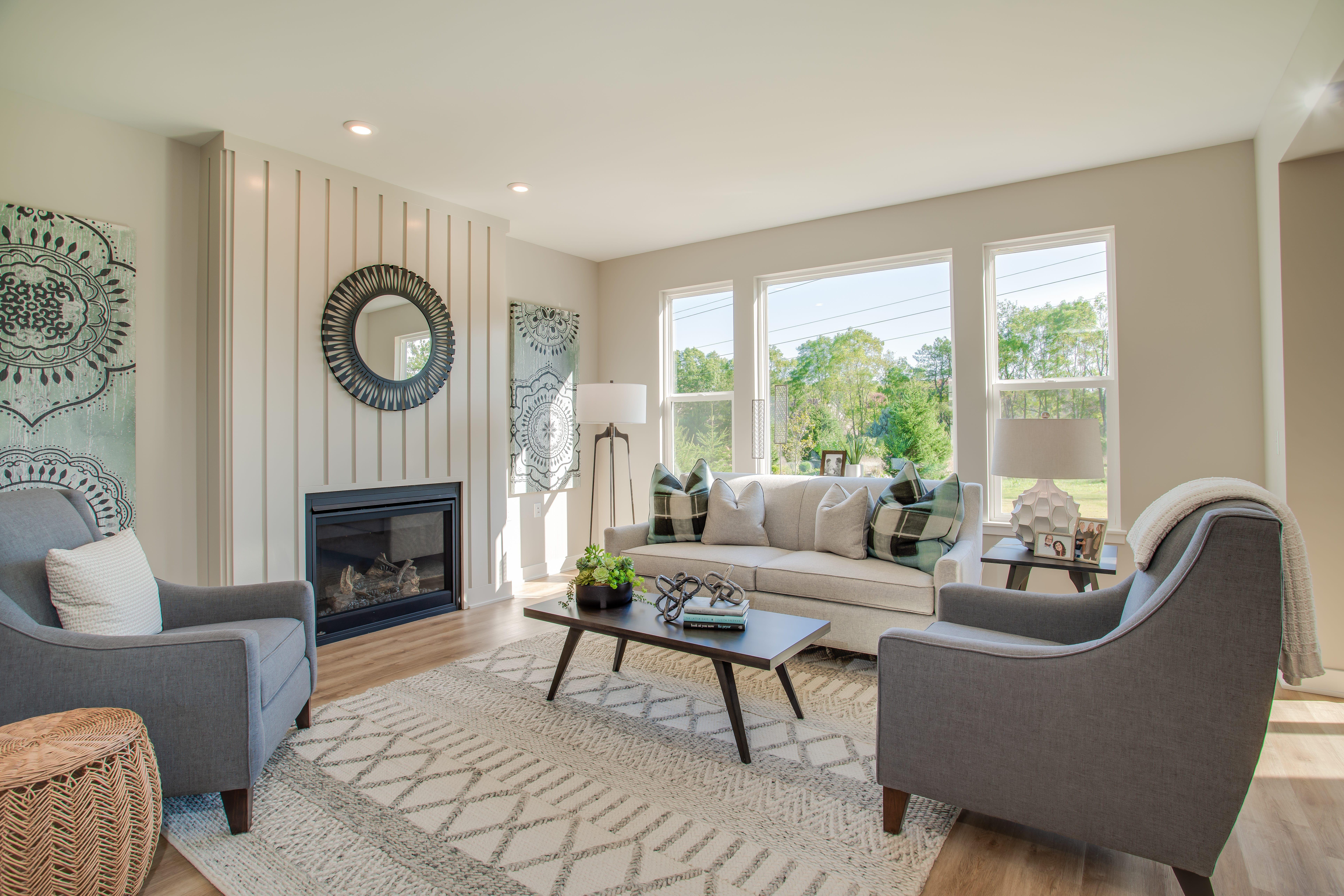 Shiplap fireplace surround, luxury vinyl plank floors in