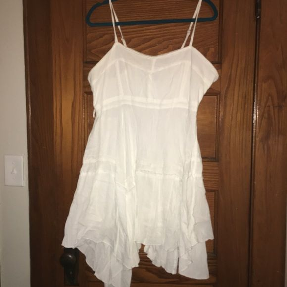 White 100% Cotton dress. Worn once for an all white beach party. Fits so cute. Im 5'8 and it was mid thigh length on me. The hem reaches different levels due to the handkerchief style. All offers through offer button only. Dresses Mini