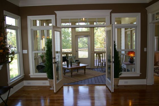 Love the french doors opening into the 4 season room for French doors back porch