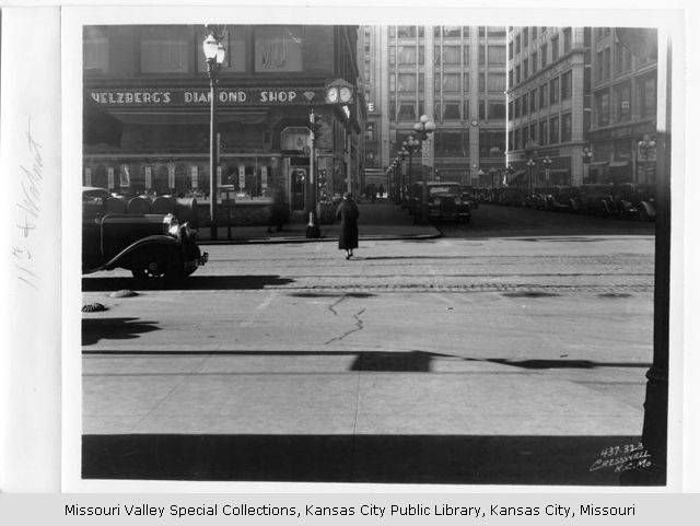 Looking west along the south side of 11th from the west side of Walnut. 1925