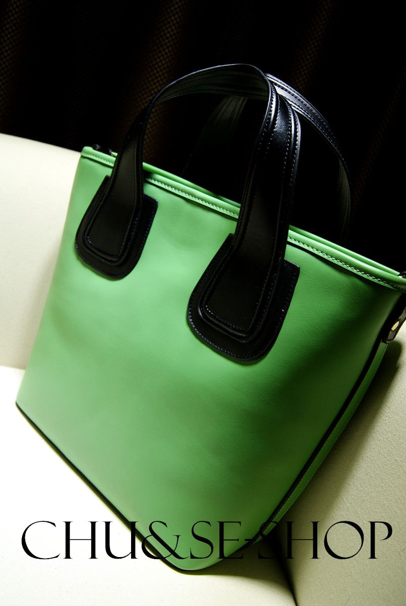 The new spring 2014 European and American wind contracted bump color cowhide leather bag spell color joker dual-use bag