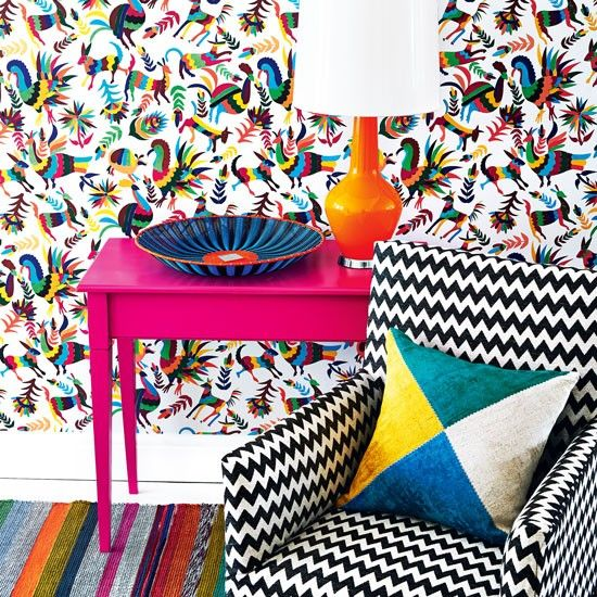 Vibrant Latin Themed Living Room With Carnival Wallpaper And Pink Side Table