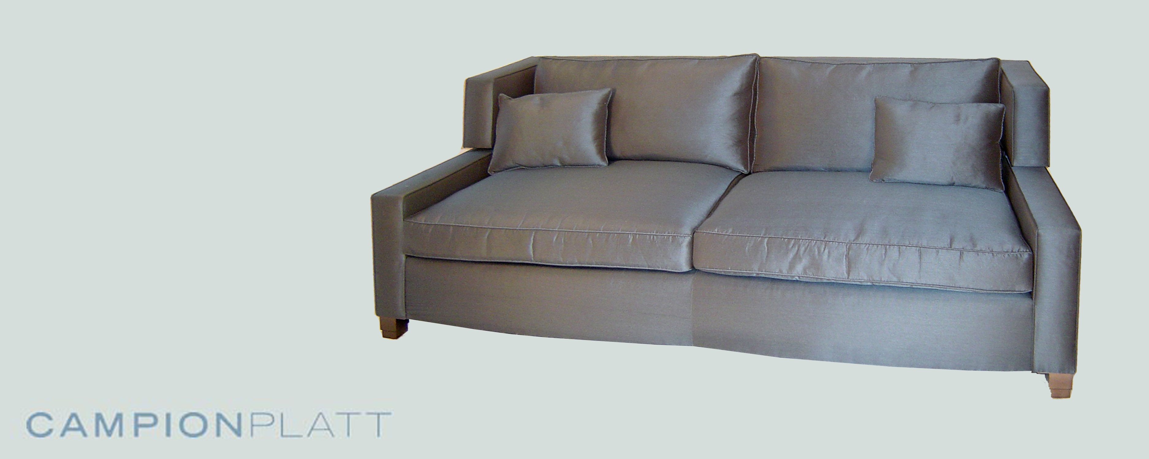 *Crystalline Collection: Sapphire Sofa* A corner backed low-slung sofa in luxurious ribbed blue silk with gunmetal feet