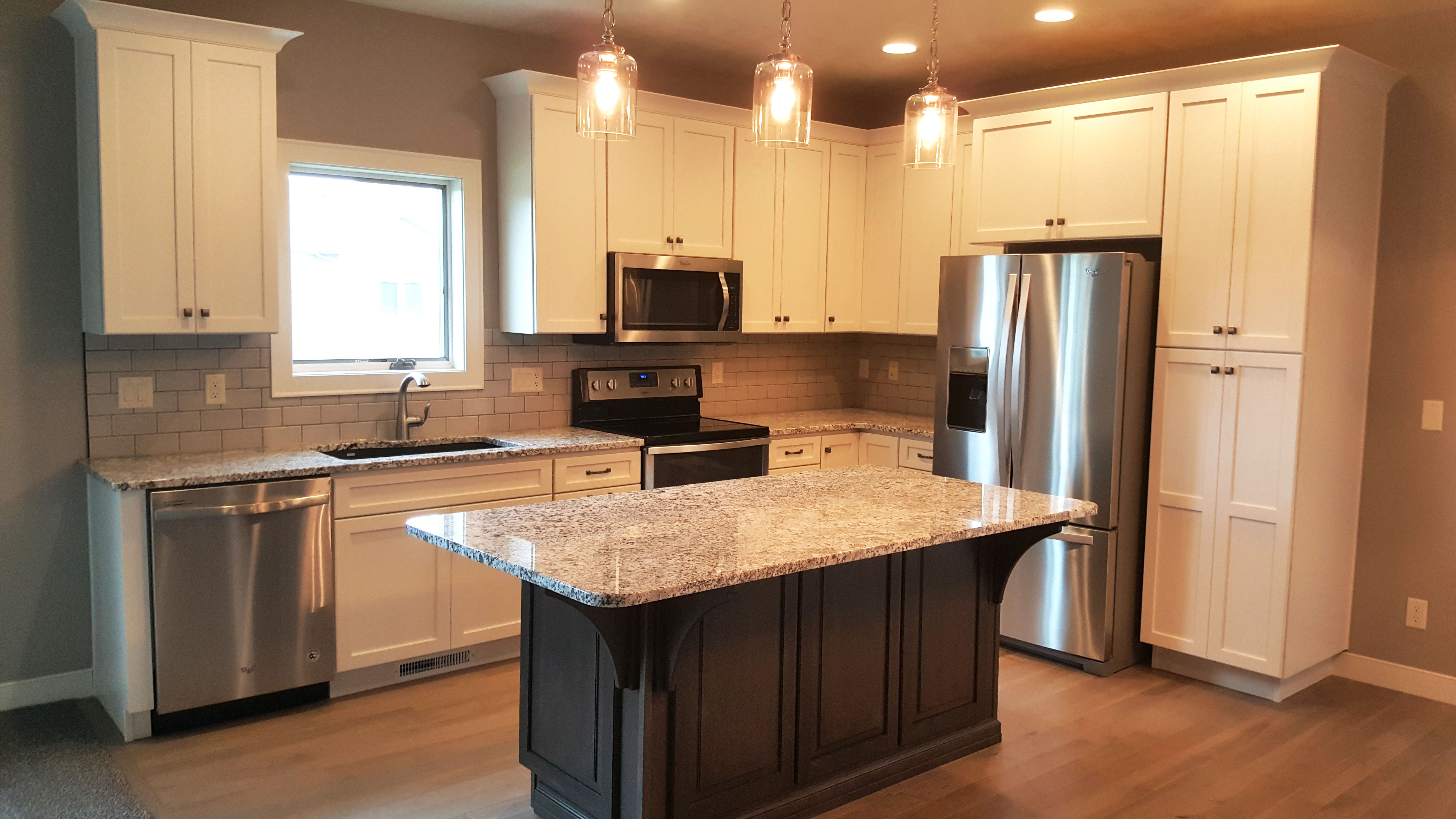 Kitchen Features Open Layout Starmark Cabinetry Cabinets In Maple Finished In Marshmallow Cream And Hardwood In Kitchen Kitchen Design Open Appliance Cabinet