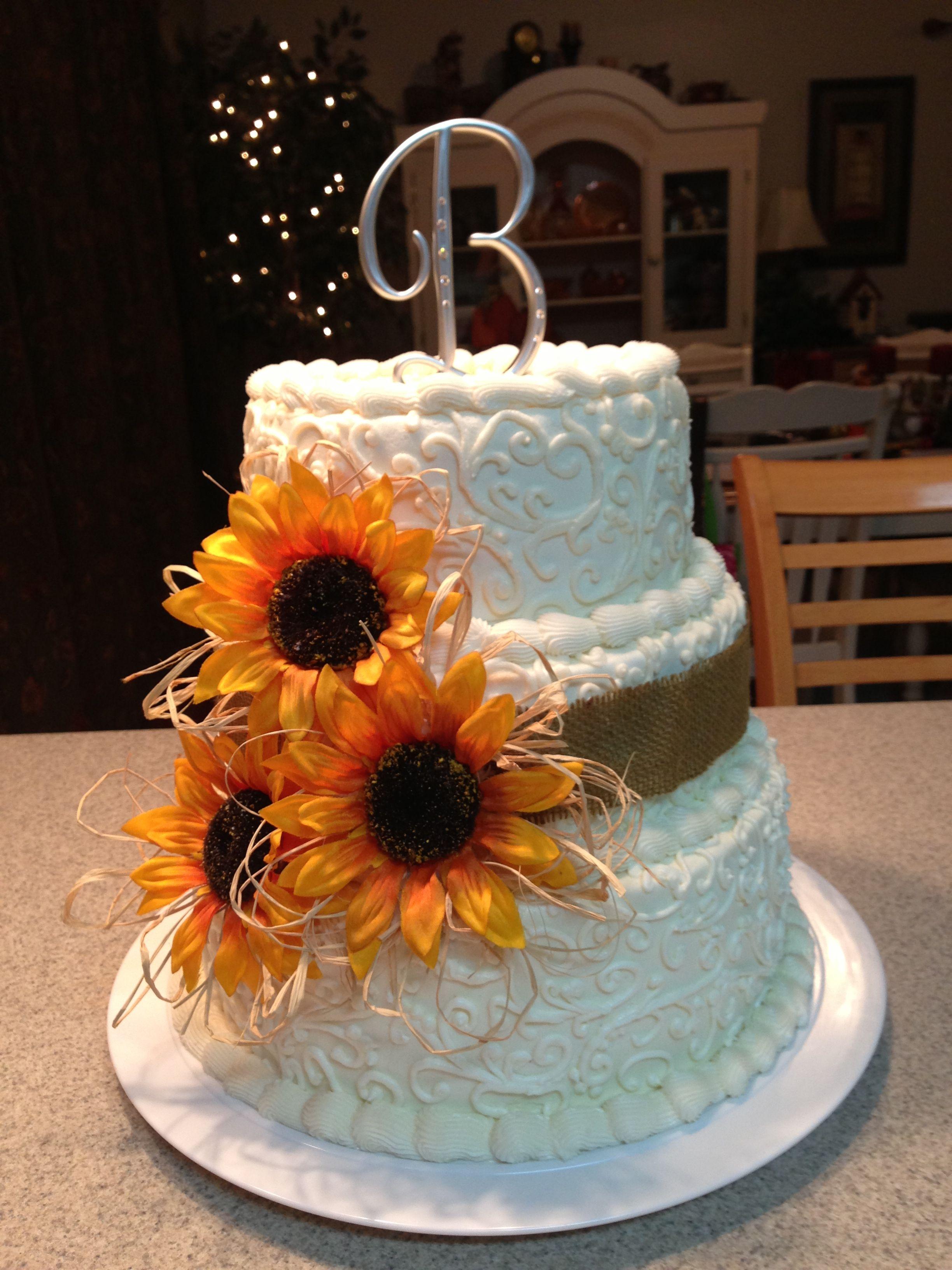 Sunflower wedding cake with burlap ribbon