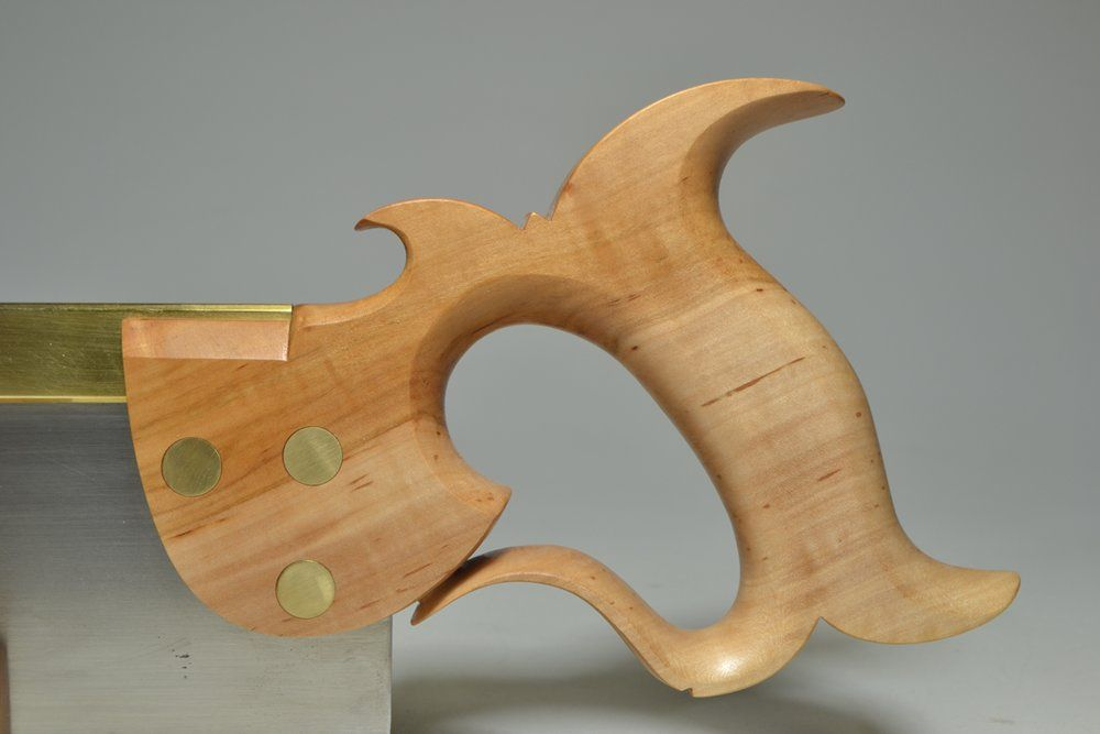 Close-up of handle on 12 inch carcase saw in apple