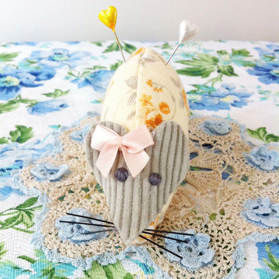 cute handmade orange floral mouse pincushion with pretty peach bow