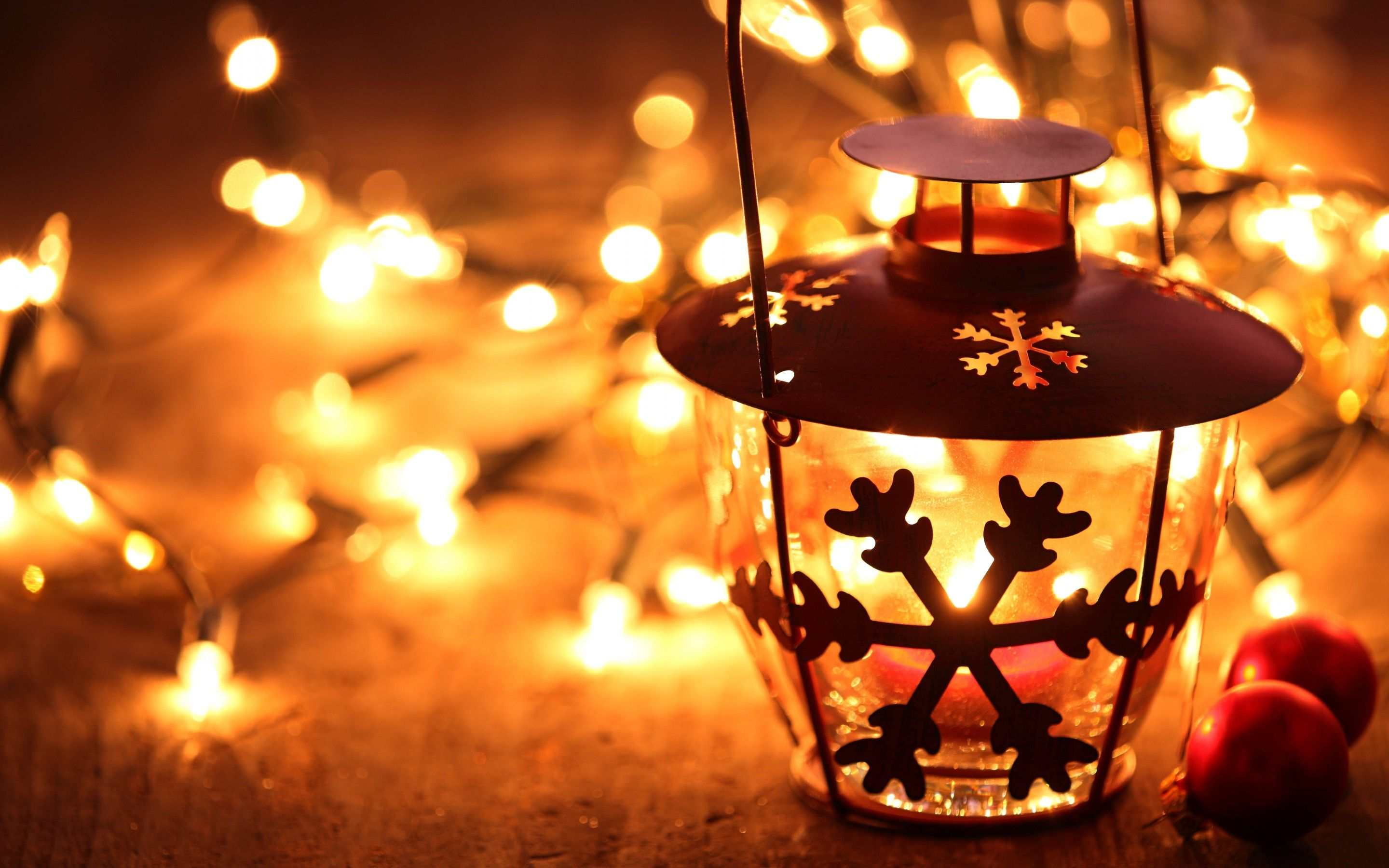 snowflake lantern on wooden floor with yellow candle light