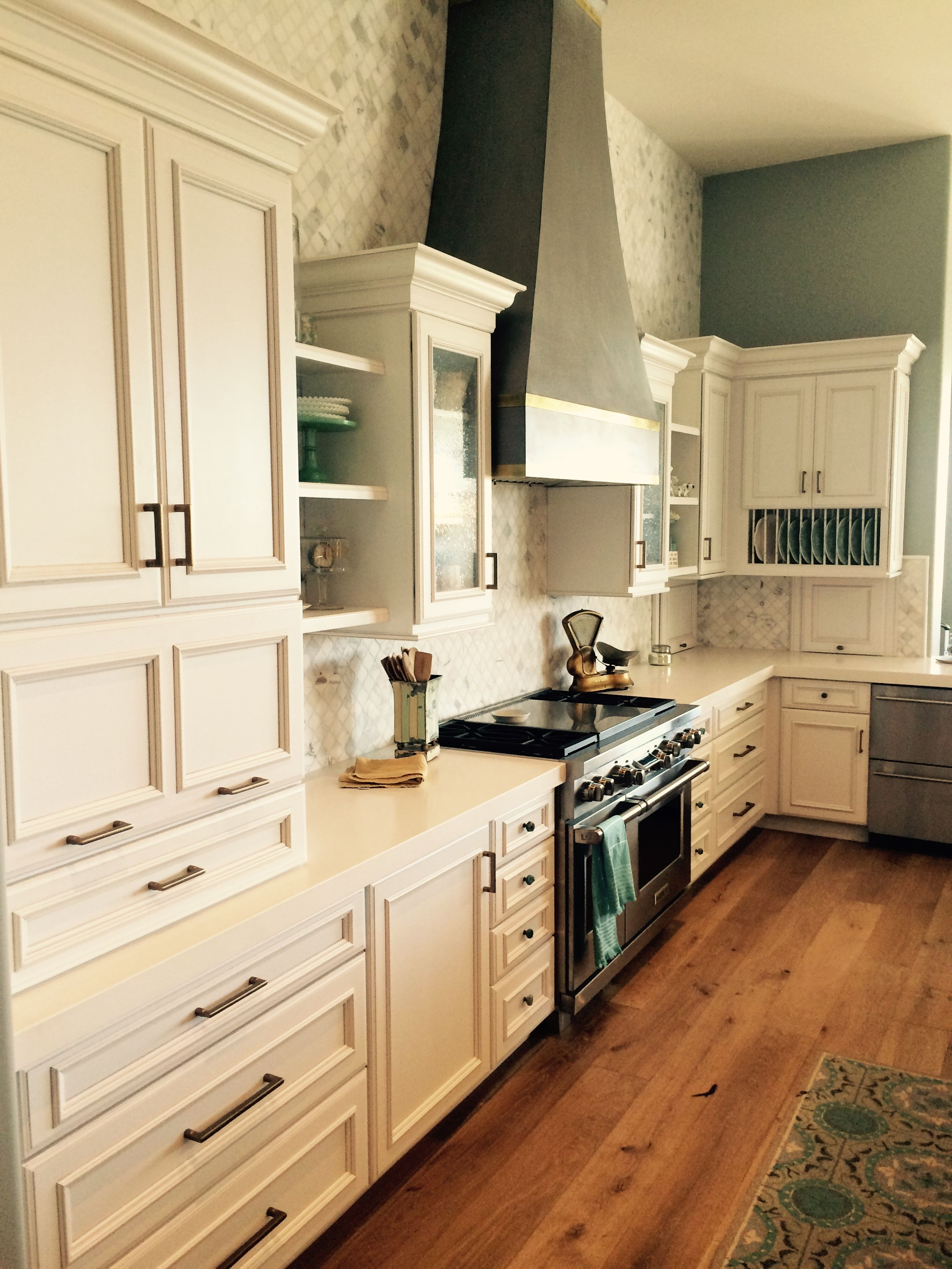 Beautiful kitchen with white cabinets and a pewter glaze ...