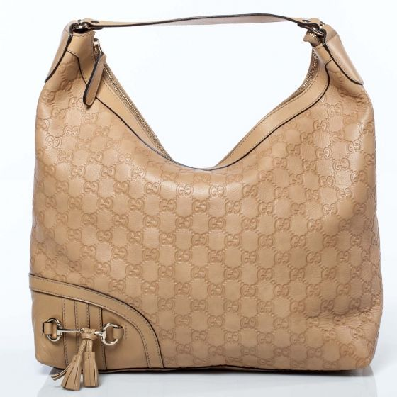 e93958ab1d68 This is an authentic GUCCI Guccissima Medium Horsebit Tassel Shoulder Bag.  This stylish shoulder bag is crafted of Gucci monogram embossed leather.