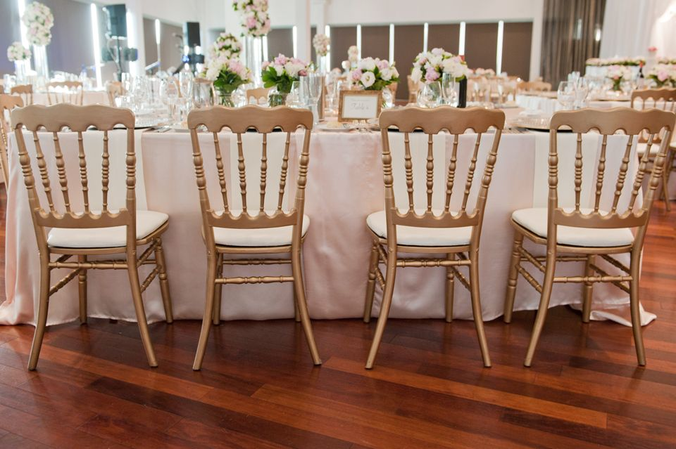 Great Gold Napoleon Chairs With White Cushion.