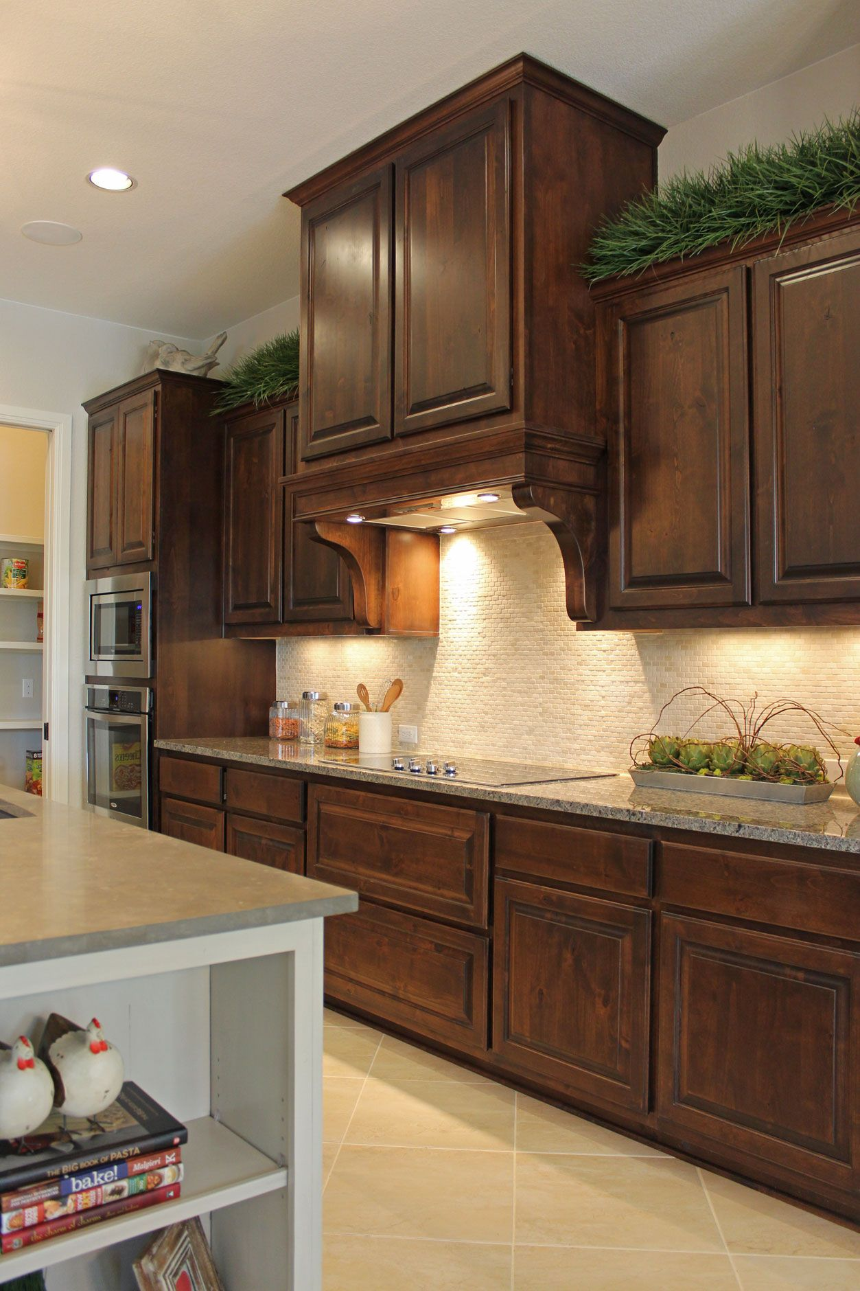 Burrows cabinets 39 kitchen cabinets in stained knotty alder for Vent hoods for kitchens