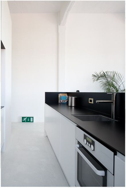 black and white kitchen - mine in reverse; black cupboard fronts, white and stainless ...