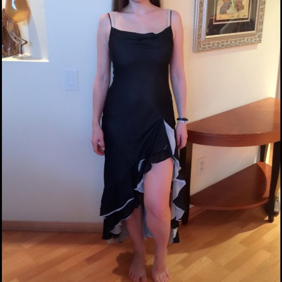 BCBG MaxAzria Classic & flirty evening gown Black & silver spaghetti strap evening dress with thigh high slit. Worn once & in perfect condition. Please contact me for any additional pictures/ info :) BCBGMaxAzria Dresses Prom