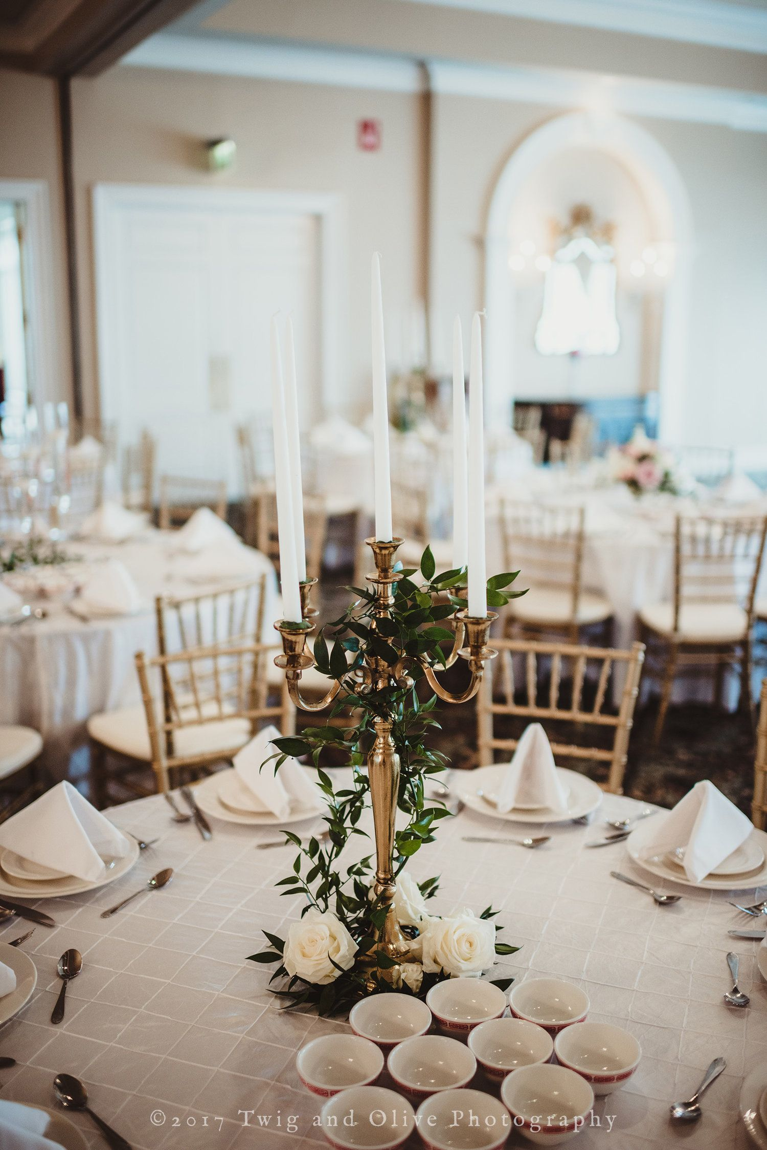 A Wedding Reception Table With Gold Candelabras Covered In Italian