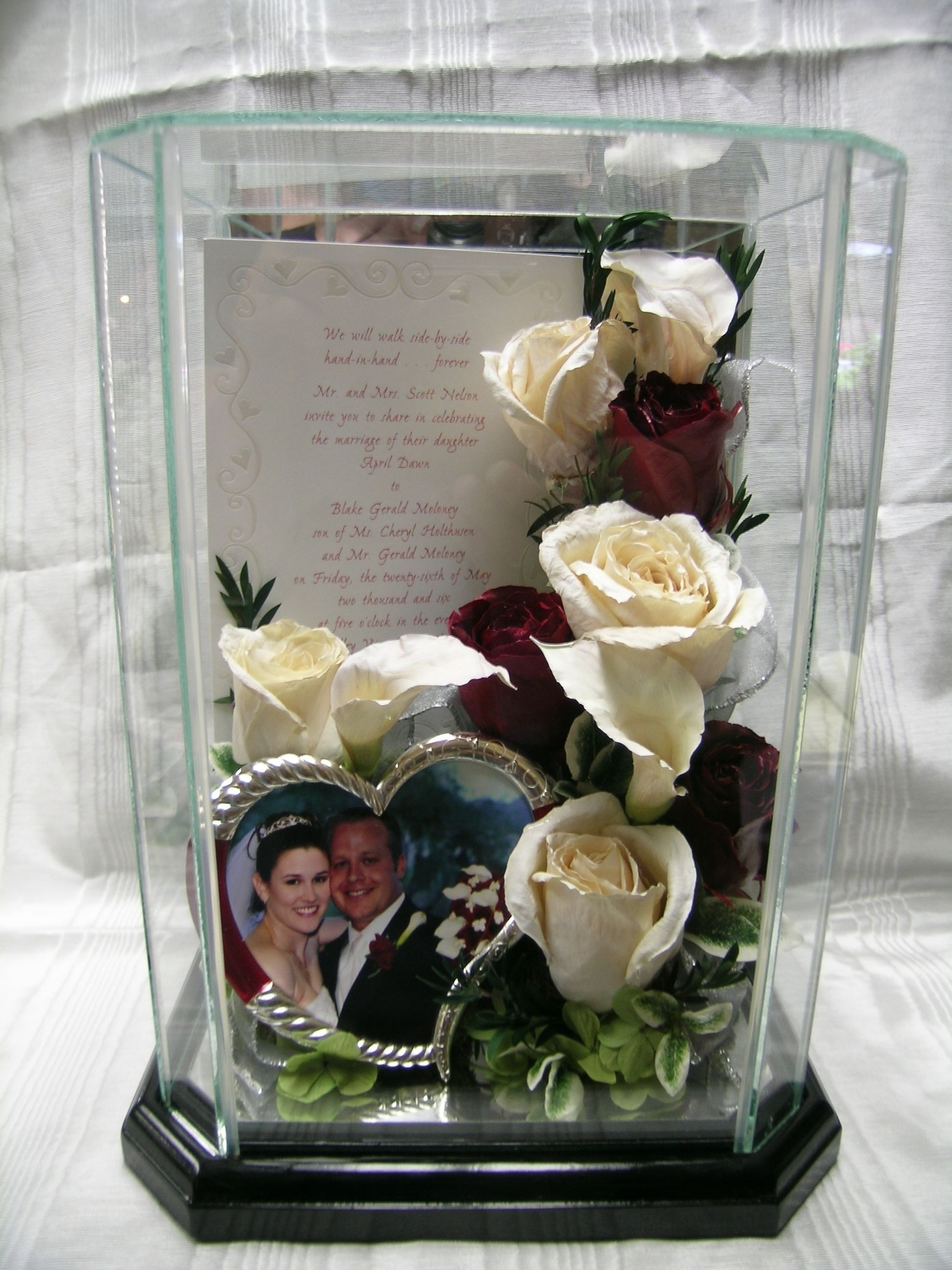 Preserved wedding flowers in a glass box.